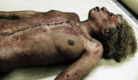 Brutalized corpse from 'Message from the King'